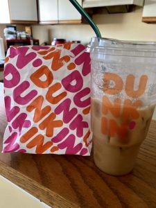 dunkin donuts bag and cold brew iced coffee
