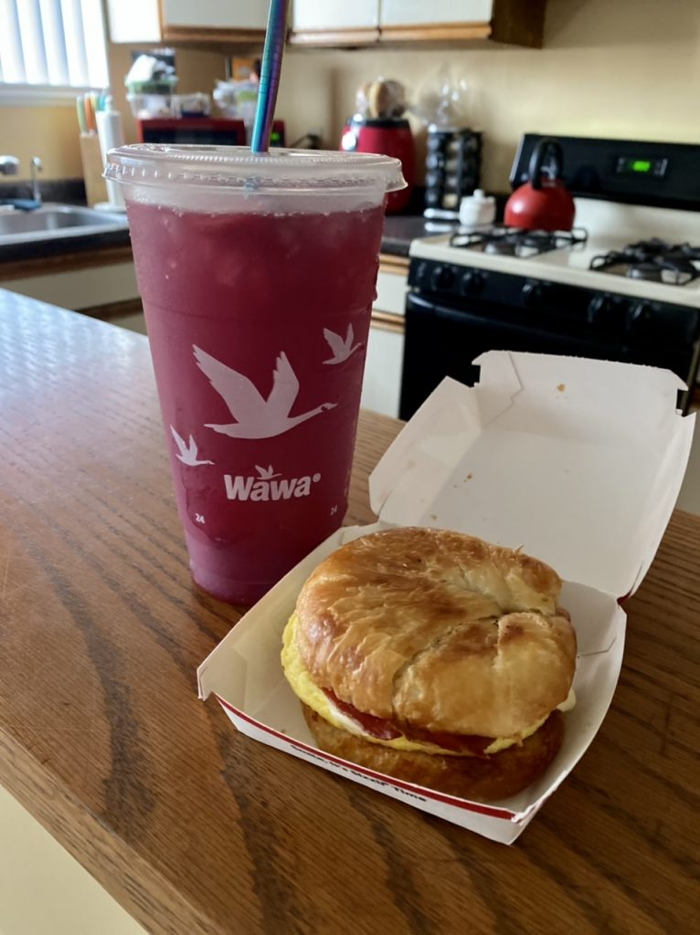 wawa bacon egg and cheese breakfast sandwich with strawberry refresher